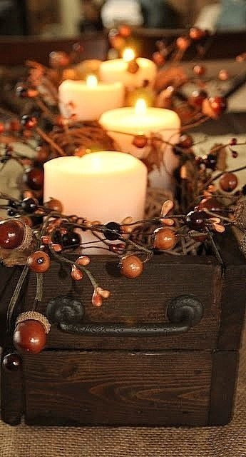 Grab some candles, acorns & twigs and put them into a rustic box for an easy, classic centerpiece- cozy!