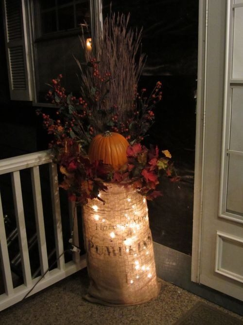 It's all about the BURLAP...grab a burlap bag and put string lights inside. Spruce it up with by arranging branches, twigs, leaves and pumpkins inside the bag. This is a great idea for your porch.