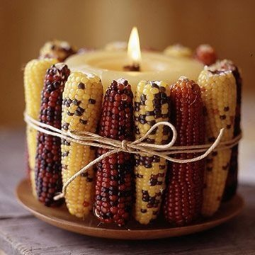 Use a hot glue gun and glue ears of corn around an old candle, wrap with twine and voilà, you've got a festive-fall centerpiece!