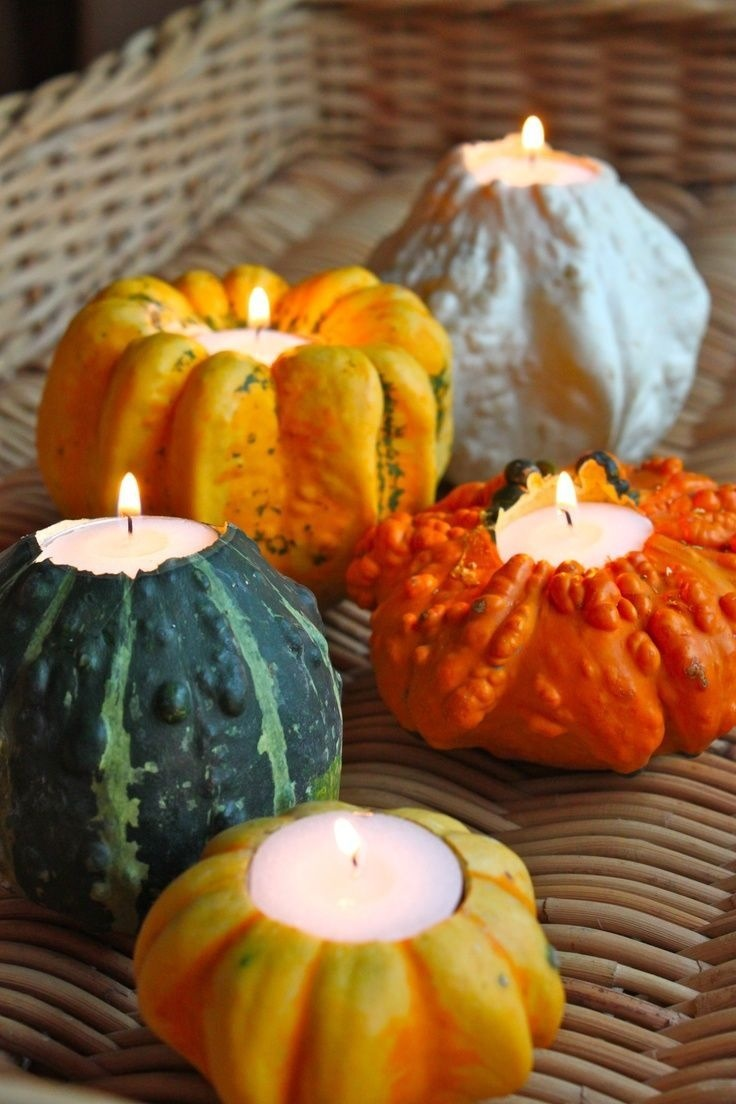 Hollow out the tops of tiny pumpkins and gourds and insert tea lights. Stunning!